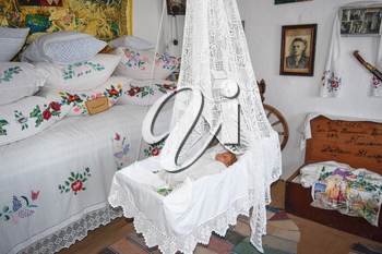 Ataman, Russia - September 26, 2015: Cradle with dolls in the bedroom. Homemade great toys for children. Recreating the image of antiquity.