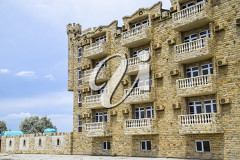 The hotel building, covered with decorative stone. Multi-storey hotel with a decorative trim, which is called Dagestani stone.