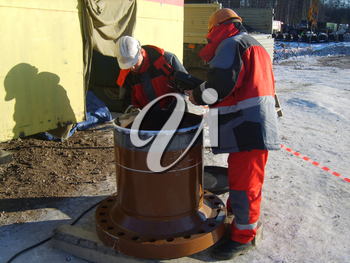 Sakhalin, Russia - 12 November, 2014: survey of quality of processing of future place of welding.