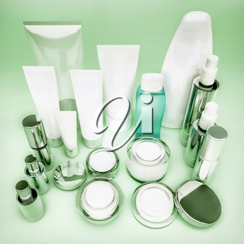 Set of cosmetic containers. Skin care products on green.