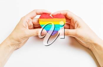 LGBT symbol in hand. Heart of the rainbow color on a white background