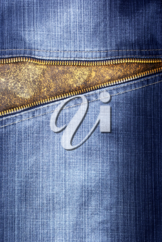 Texture of jeans with zipper. Element of design.