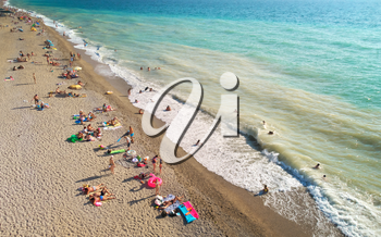 Aerial view at the beach. People relax on the sea shore. Beautiful natural seascape and summer time
