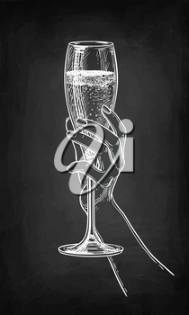Hand holding a glass of champagne. Chalk sketch on blackboard background. Hand drawn vector illustration. Retro style.