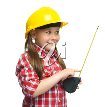 Happy cute girl as a construction worker with tape measure, isolated over white
