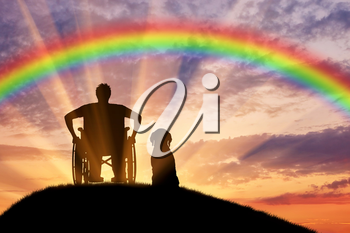 Disability. A disabled person in a wheelchair next to his dog at sunset and rainbow background