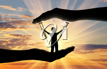 Disabled child standing with crutches in hand sunset. Concept children with disabilities