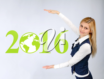Business woman presents 2016. Business concept and globalization