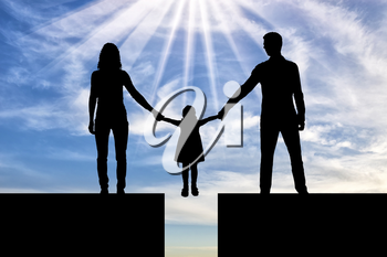 Divorce in the family. Silhouette mom and dad hold the hands of his child who is over the precipice. The concept of divorce and division of children
