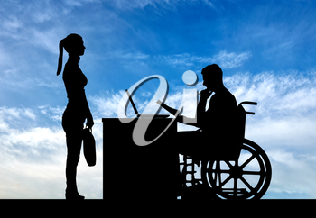 Silhouette of a man a businessman disabled in a wheelchair sitting at a table holds an interview with a woman about hiring a job. The concept of working disabled people
