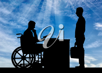 Silhouette of a man a businessman disabled in a wheelchair sitting at a table holds an interview with a man about hiring to work. The concept of working disabled people
