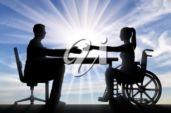 Handshake of a disabled woman in a wheelchair and a man. Disabled worker
