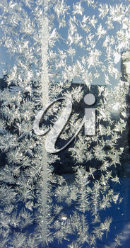 Photos of beautiful frost pattern on a window glass.