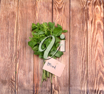 Mint on wooden Tagged with top view