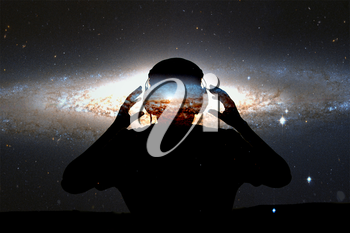 Silhouette young man with headphone on stars background. This image elements furnished by NASA.