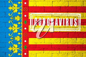 Flag of the regions or communities of Spain Valencia with original proportions. stamped of Coronavirus. brick wall texture. Corona virus concept. On the verge of a COVID-19 or 2019-nCoV Pandemic.
