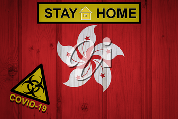 Flag of the Hong Kong in original proportions. Quarantine and isolation - Stay at home. flag with biohazard symbol and inscription COVID-19.