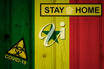 Flag of the Senegal in original proportions. Quarantine and isolation - Stay at home. flag with biohazard symbol and inscription COVID-19.
