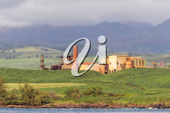 Old sugar mill or factory now abandoned on the coast of Kauai in Hawaii