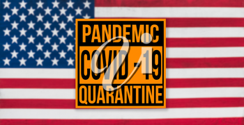 Pandemic sign warning of quarantine due to Covid-19 or corona virus in the USA using a US flag in the background
