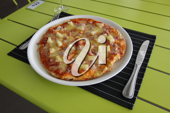 Tasty pizza. Restaurant menu. Dishes which give at restaurants