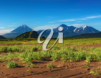 Mountain landscape with volcanoes and blue sky, Kamchatka