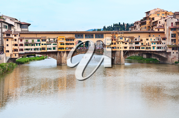 View of the Arno river and Bridge Ponte Vecchio. Florence, Italy.