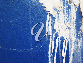 Aged street wall background with colorful paint splashes