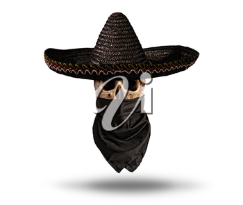 human skull in wide-brimmed dark mexican hat and bandanna isolated on white background