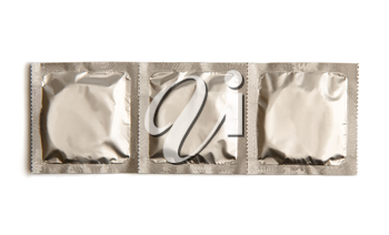 ribbon of three condoms in sealed silver packaging without text isolated on white background