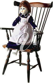 Royalty Free Photo of a Doll Sitting in a Wooden Children's Chair