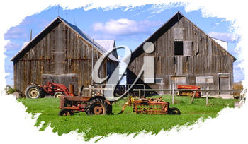 Royalty Free Photo of Two Barns and Tractors