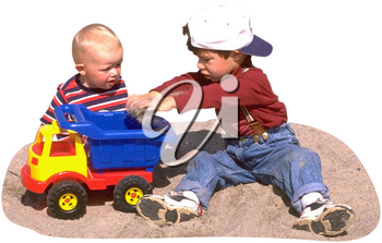 Royalty Free Photo of Two Children Playing in the Sand