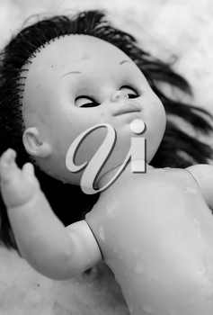 Black and white shot of scary plastic doll.
