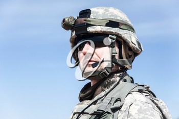 Portrait of United states airborne infantry man, camouflage uniforms dress. Combat helmet, tactical light, headphones, radio microphone on his mouth
