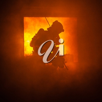 Assault team member comes through the window on fire