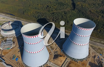 Aerial survey of a nuclear power plant under construction. Installation and construction of a power plant. Nuclear power.