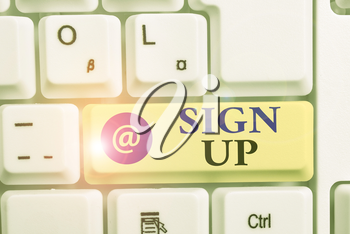 Writing note showing Sign Up. Business concept for use your information to register in website team college or blog White pc keyboard with note paper above the white background