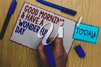 Conceptual hand writing showing Good Morningand Have A Wonderful Day. Business photo text greeting someone in start of the day Man holding marker paper clothespin express ideas wooden table