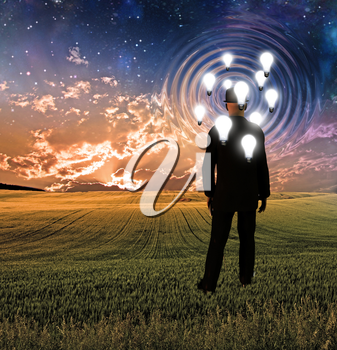 Surreal landscape with man and idea bulbs