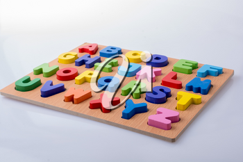 Colorful letter blocks on board on white background