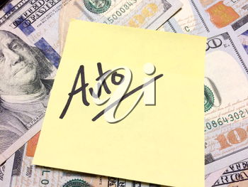 American cash money and yellow sticky note with text Auto in black color aerial view