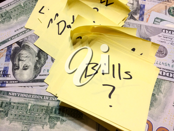 Dollar bills cash with many post it notes in sharpie marker black color aerial view