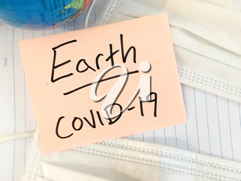 Coronavirus COVID-19 infection medical cases and deaths on Earth. China COVID respiratory disease influenza virus statistics hand written on surgical mask and earth globe background