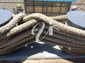 Rope large braided mooring line for ships boat background element on USS Iowa naval warship destroyer battleship