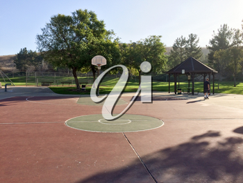 Basketball court outdoor at park no people on sunny day