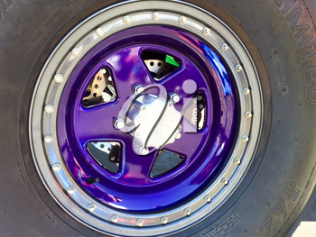 Modern purple car truck wheel and rubber sandrail tire off road racer powder coating